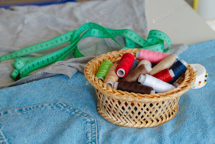 Basket full of colorful .spools of thread