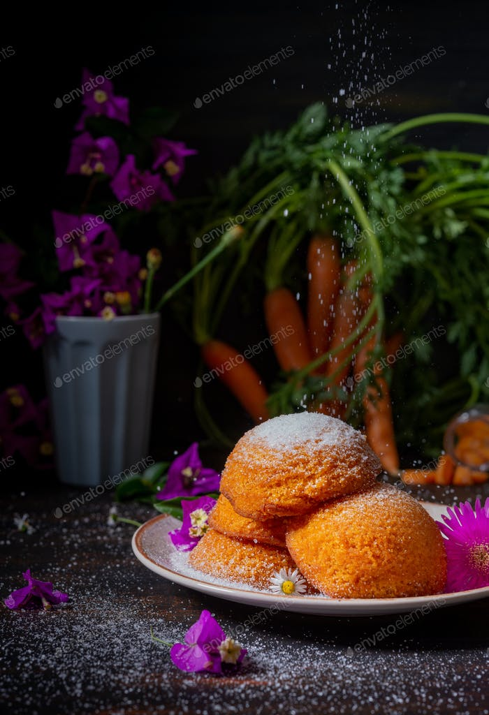 small carrot cakes withpowder sugar