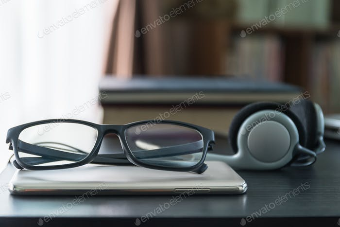 Headphones with book and mobile phone_-8