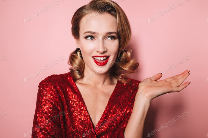 Close up young pretty smiling woman with wavy hairstyle and red