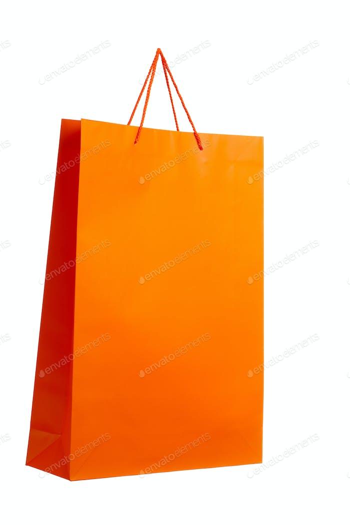 Orange paper bag on white