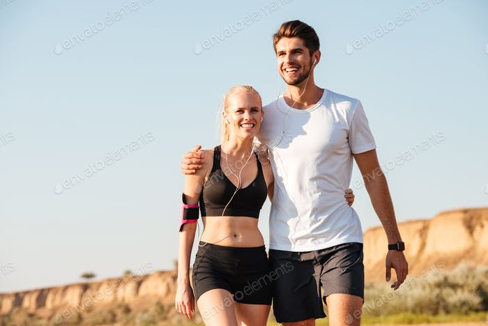 Young couple taking a break from exercises