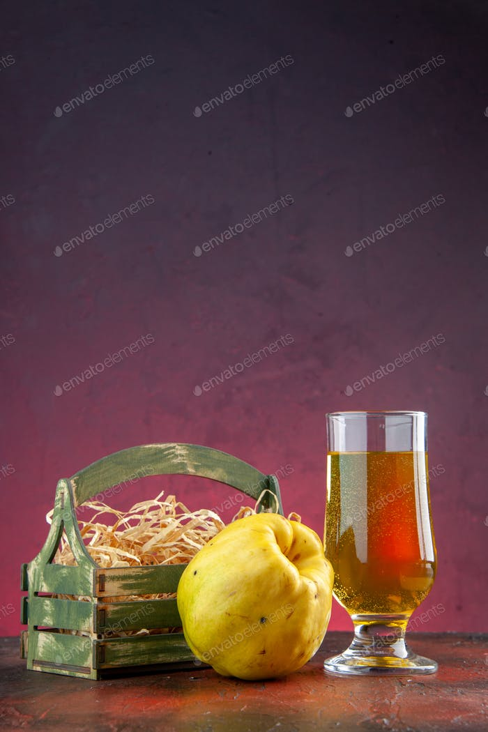 front view quince juice with fresh quince on the dark-pink background photo fruit diet food tree