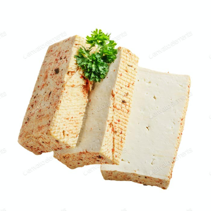 Soy Bean curd tofu with greens isolated on white background Non-