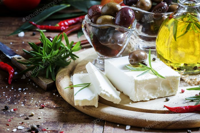 Soft greek feta cheese with rosemary, olives