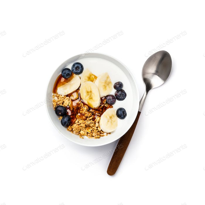 Oat granola with fresh blueberries, banana, yogurt and maple syrup