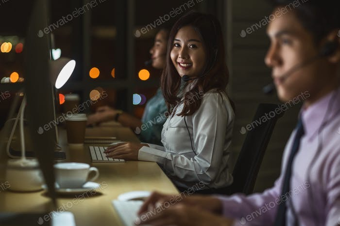 Portrait of Asian Female customer care service with business man smiling