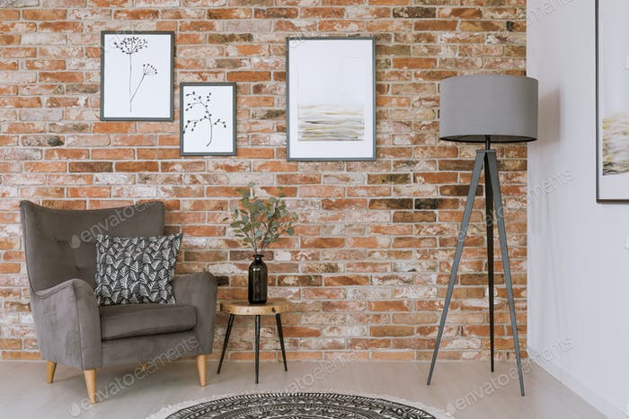 Gray furniture against brick wall