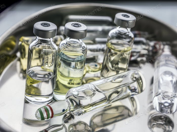 Several ampoules and vials in a tray of a hospital, palliative care, conceptual image