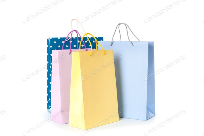 Multicolor paper bags isolated on white background