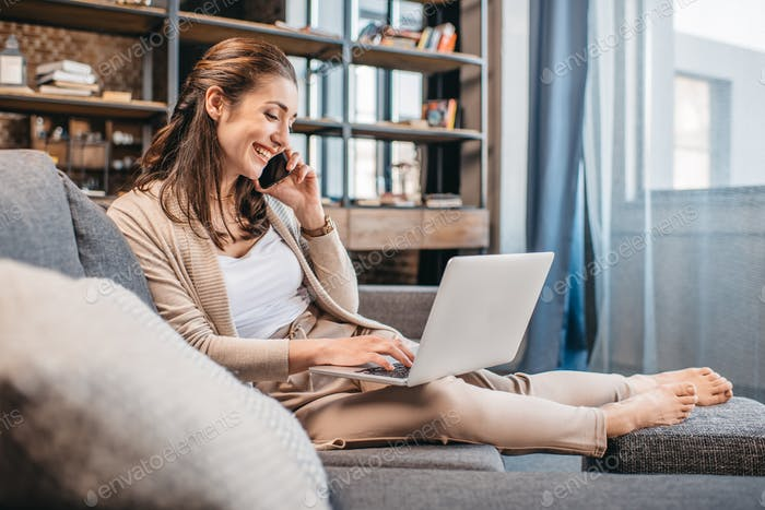 Businesswoman remote working and using digital devices at home