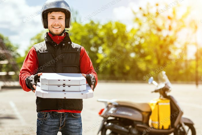 Cheerful Courier Holding Pizza Boxes Smiling To Camera Standing Outdoors