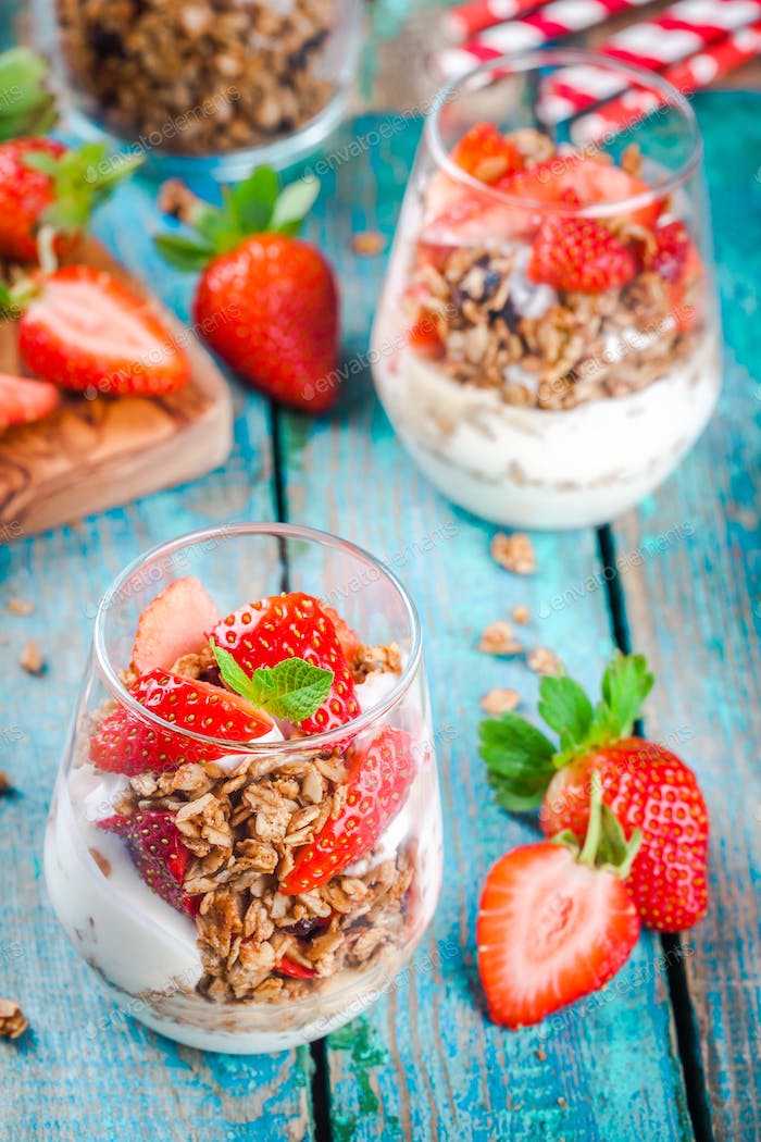 Homemade granola parfait with strawberry and mint