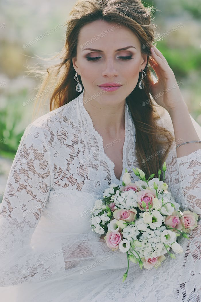 Amazing Happy young woman in wedding dress