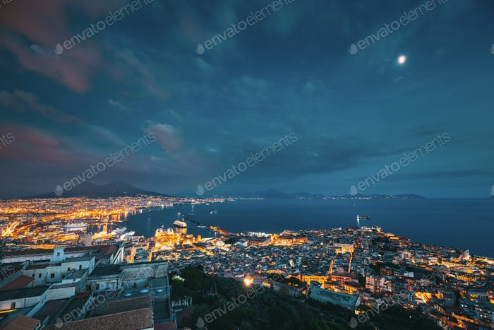Naples, Italy. Skyline Cityscape In Evening Lighting. Tyrrhenian Sea And Landscape With Volcano