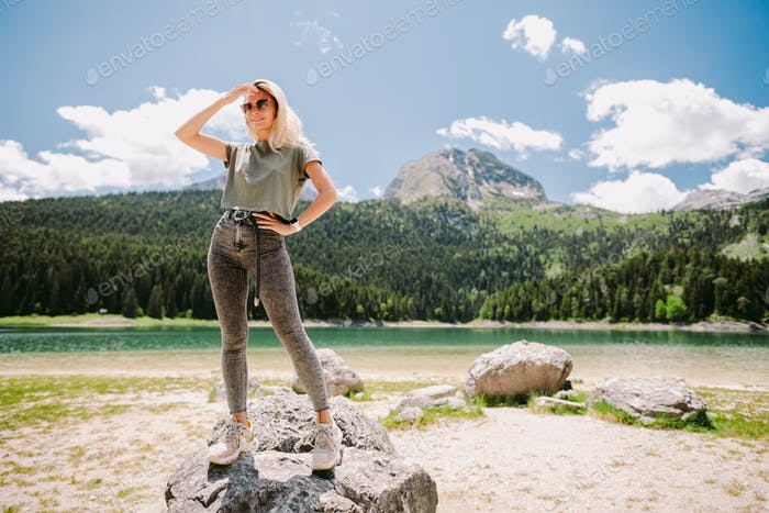 attractive woman relax in mountains with lake view
