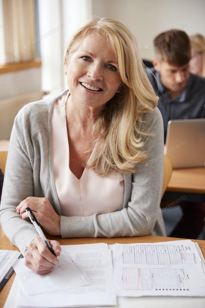 Portrait Of Mature Woman Attending Adult Education Class