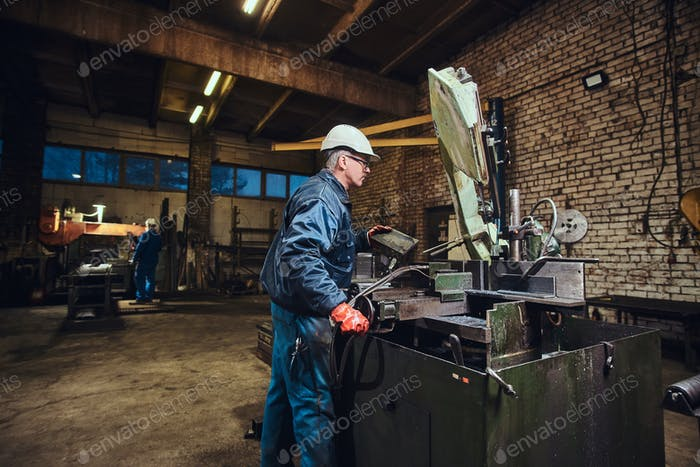 Man is working at metal factory