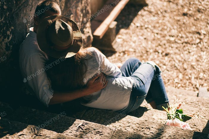 couple relax and kiss in park