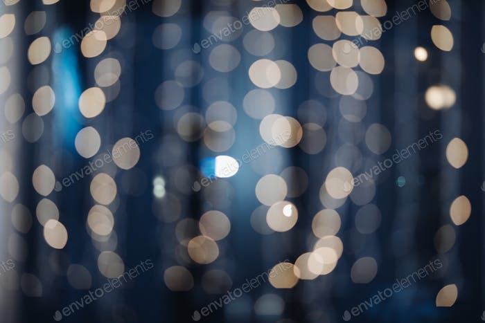 Color Bokeh against a dark background Abstract blurred circles