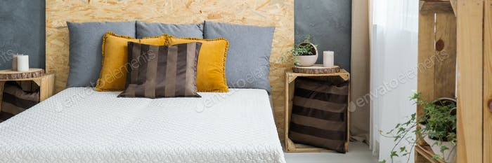 Bed with wooden headboard