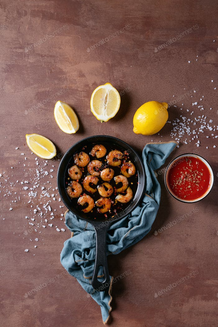 Fried shrimp prawns on frying pan