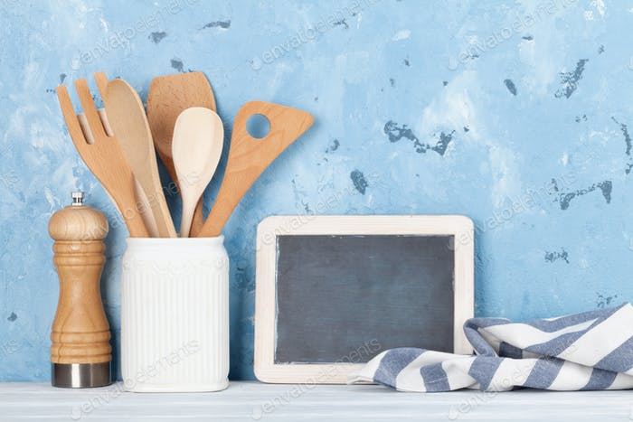 Kitchen utensils and chalkboard