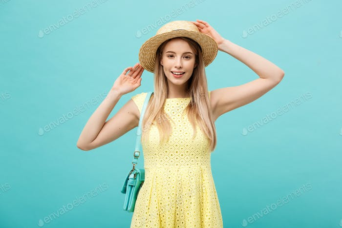 Travel concept - Close up Portrait young beautiful attractive girl wtih trendy hat and smiling. Blue