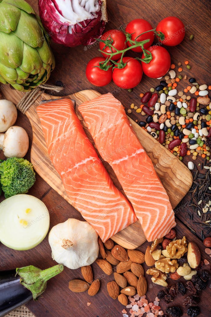Raw salmon fillets fresh, healthy uncooked slices of fish on wood