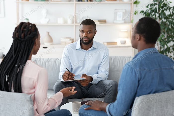 Professional Marriage Counselor Listening Problems Of Black Millennial Couple During Therapy Session