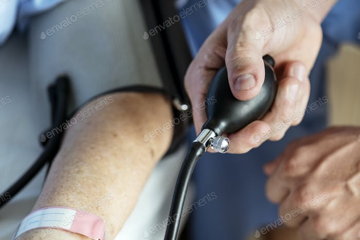 Elderly woman checking blood pressure