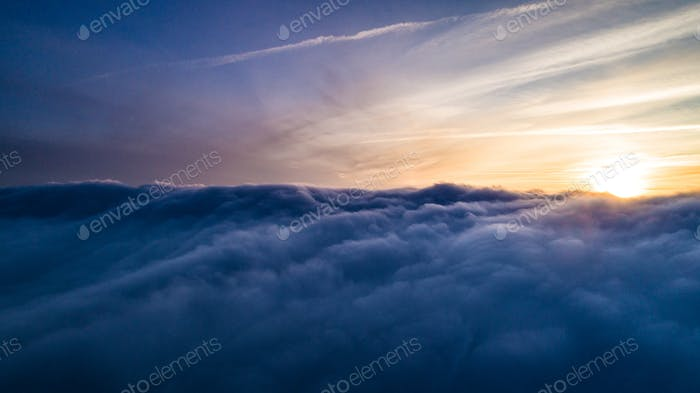 Aerial sunny view Mystical gray winter clouds