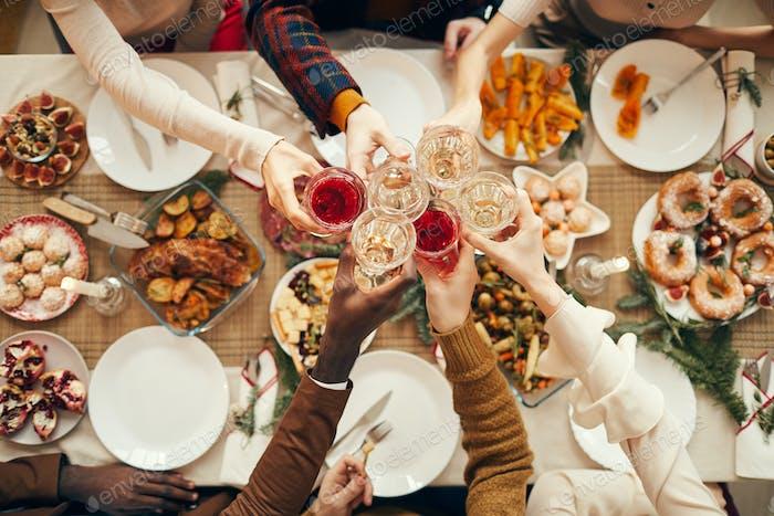 Celebration Toast over Festive Dinner Table