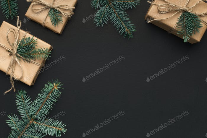 Fir branches and gift boxes on dark background