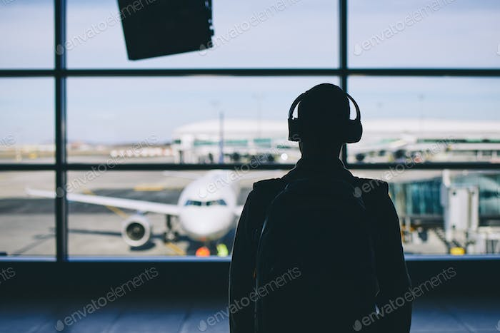 Traveler with headphones