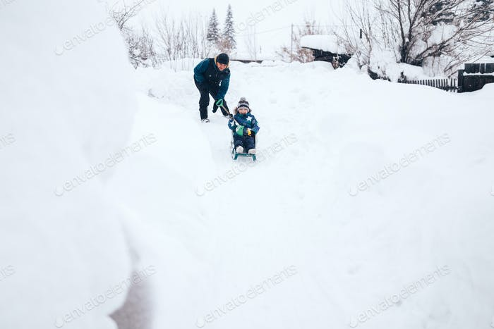 hild sledding downhill
