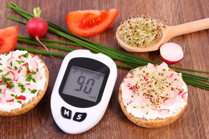 Glucometer for checking sugar level and freshly sandwich with vegetables, diabetes concept