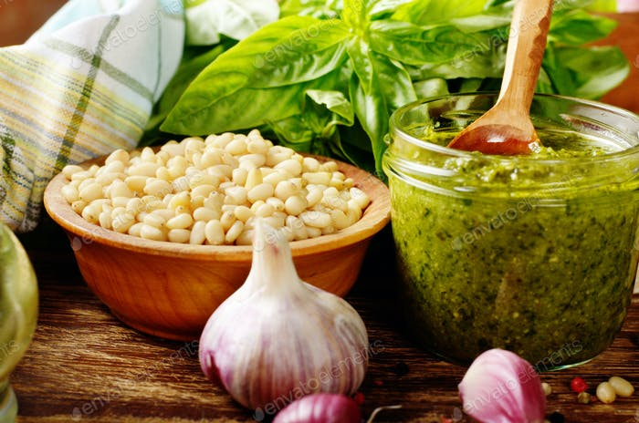 Front view of Pesto sauce and ingredients