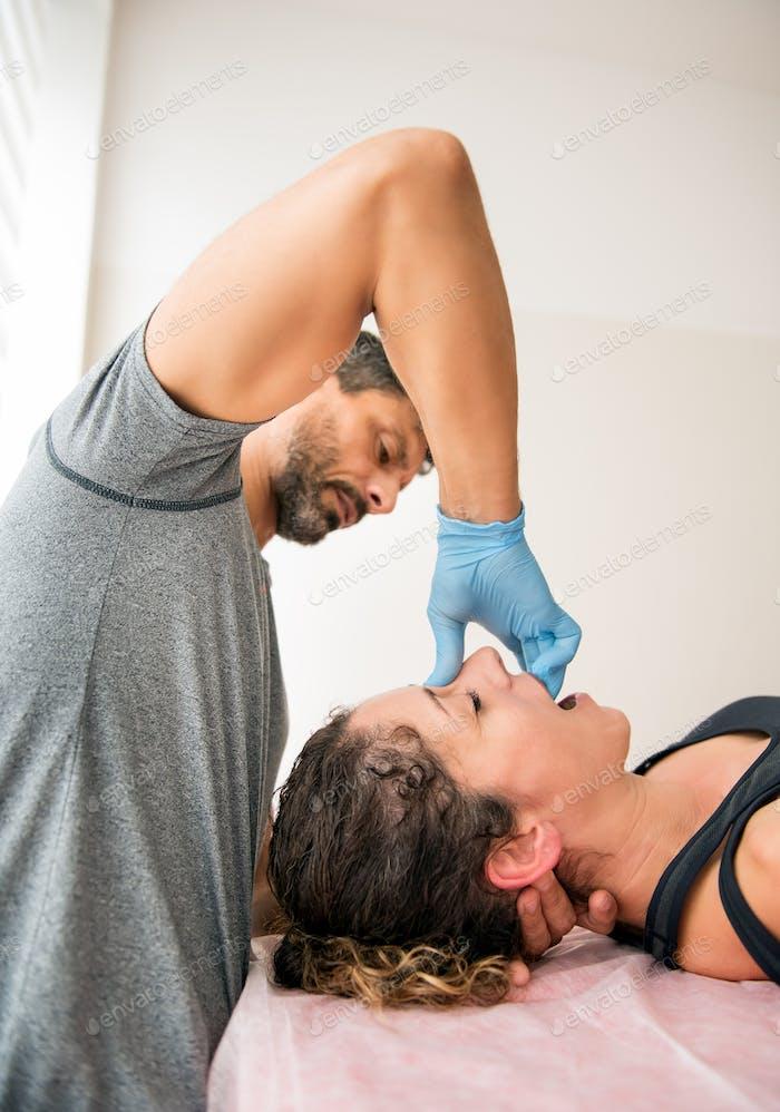 Osteopath working on paranasal sinuses
