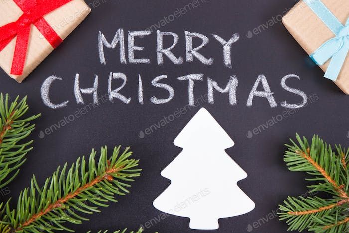 Inscription Merry Christmas, wrapped gifts, christmas tree and spruce branches