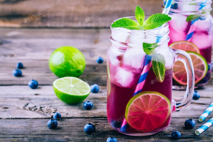 Blueberry detox water with lime and mint in mason jar