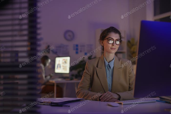 Female Office Worker Looking At Screen