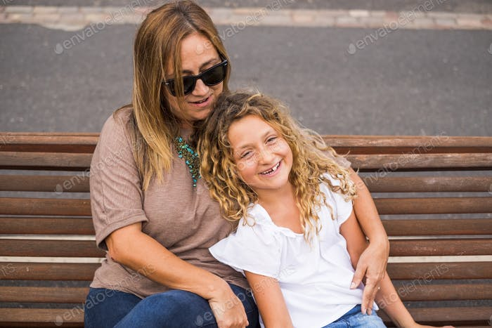 family couple mother and daughter together in outdoor happy leisure activity