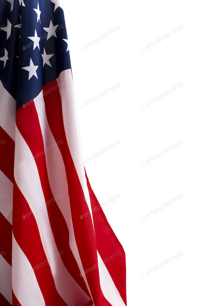 Wavy US national flag isolated on white background