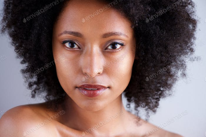 Close up beautiful african woman with curly hair and naked shoulders