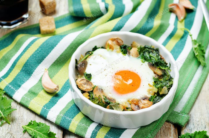 Kale mushrooms baked egg with cups of coffee
