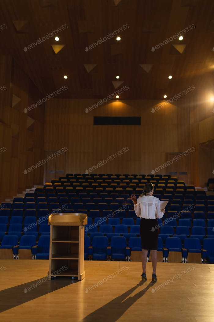 Businesswoman practicing and learning script in the auditorium