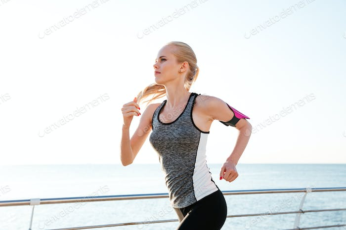 Concentrated young woman athlete working out