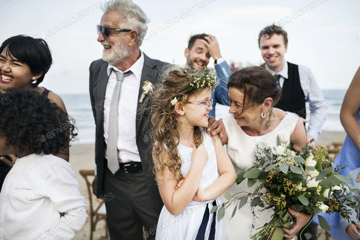People attending a beach wedding ceremony