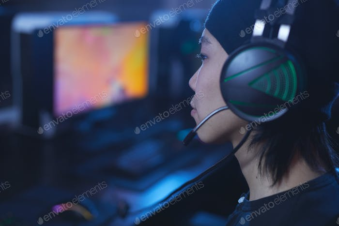 Asian Gamer Wearing Headset